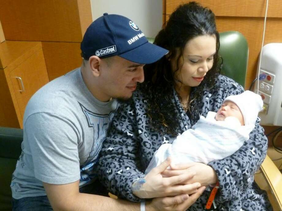 Benny Carrasquillo and Marta Valez celebrate the new year with their son, Jayden.