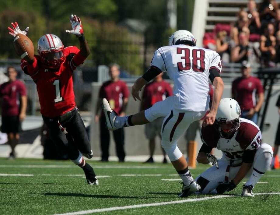 Jermaine Stevens (1) of South Houston was probably the only high school football player in the country to block three PATs this weekend, diving in and stuffing this first-half kick attempt by Nicholas Keller Saturday afternoon. Photo: Kar B Hlava
