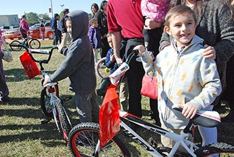 Reed students get to touch their new bicycles for the first time on Sunday morning.