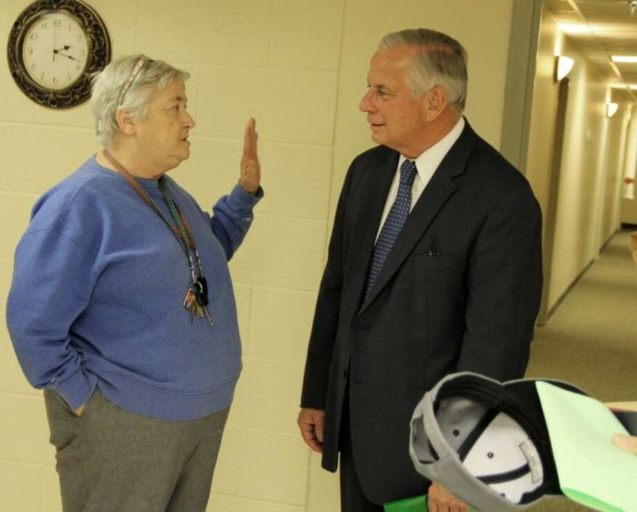 Congressman Gene Green talks with a Pasadena resident at an informal town hall meeting Monday (Nov. 25). Photo: KRISTI NIX