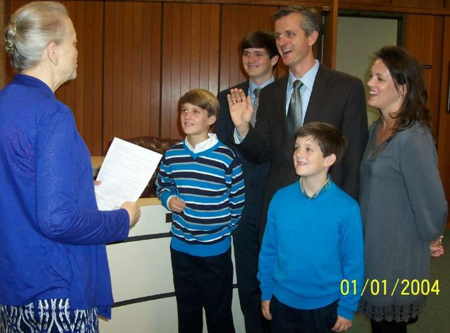 Tomball city Secretary Doris Spear, swears-in local business owner Chad Degges as he files to run in the January Special Election for the vacancy for City Council position 3. With Chad were wife Jennifer and sons: Andrew-14, Charlie-12 and Joe 8. Photo: Submitted