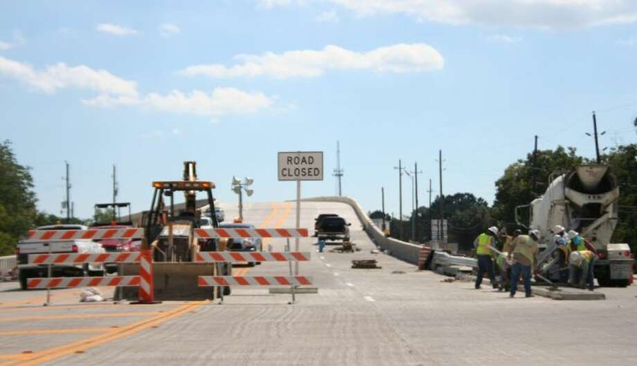 Contractors are pushing for the Crosby bridge to be completed by Oct. 18. The last requirement -- a traffic beacon is in the process of being acquired. Photo: Nate Brown