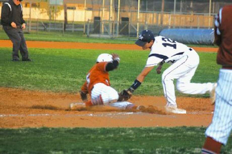 Sam Rayburn third baseman Brandon Villanueva applies the tag on Alvin's Ernie Martinez, preventing a steal of the bag in the second inning Friday.