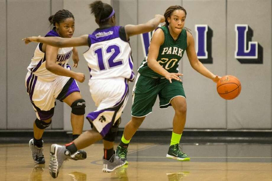 Kingwood Park's Tavia Marshall attempts to break a press during the Lady Panthers' 52-43 win over Humble on Tuesday at Humble High. Photo: ANDREW BUCKLEY