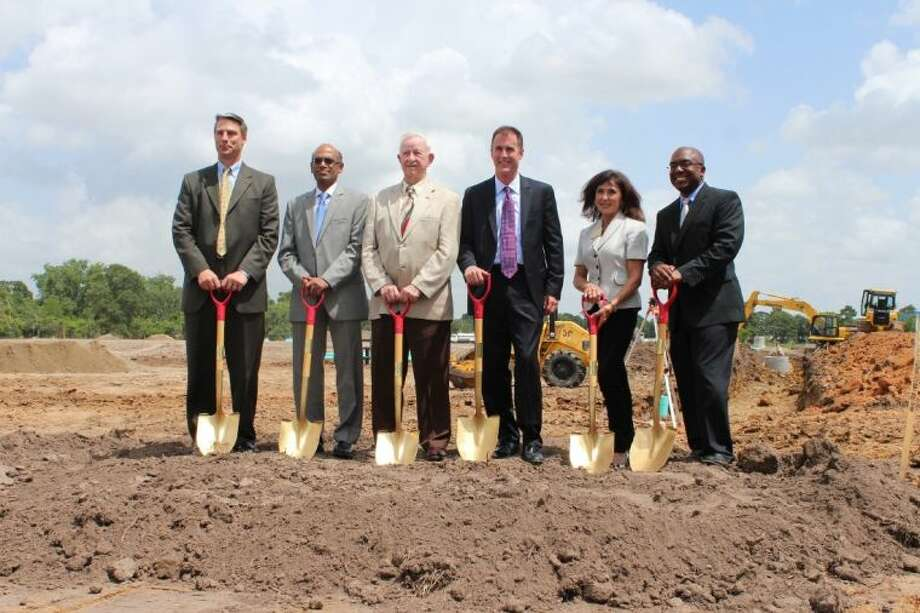 On June 11th, Dover Energy, along with leadership from the City of Pearland and the Pearland Economic Development Corporation, kicked off construction with a groundbreaking ceremony for the global manufacturer's new 150,000 square-foot facility in Pearland's Lower Kirby Urban District. Pictured from left to right: Frank Wierengo, President, Cook Compression; Soma Somasundaram, Executive Vice President, Dover Energy; Tom Reid, Mayor, City of Pearland; Jay Burnette, President, Waukesha Bearings; Carol Artz-Bucek, President/CEO, Pearland Chamber of Commerce; Charles Gooden, Jr., Chairman, Pearland Economic Development Corporation Photo: Submitted Photo