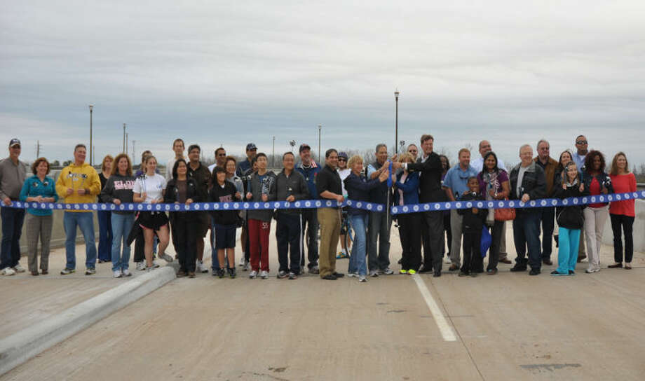 Residents and City Officials at the University Boulevard Sneak Peek event for the ribbon cutting ceremony.