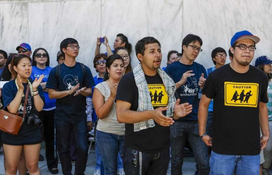 Immigrant students join a coalition of immigrant rights supporters on a 24-hour vigil calling on the U.S. Congress to pass immigration reform outside the Federal Building in Los Angeles Thursday.