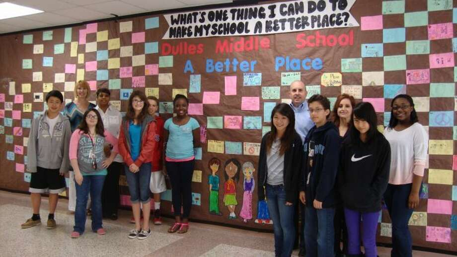 Pictured in front of the Diversity Wall are (from left to right): Chris Hu, Dana Cox, Librarian; Nicole Dew, Vicky Smith, Counselor; Taylor Miller, Nick Falsone, Arielle Richards, Julie Mai, Greg Foulds, Assistant Principal; Sam Steinman-Friedman, Sylvia Salinas, Associate Principal; Anastasia Paul and Isioma Abili.