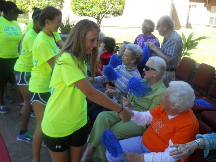 Students from Westside High School made a special stop by Parkway Place to say hi to seniors during their annual homecoming parade. Photo: Submitted