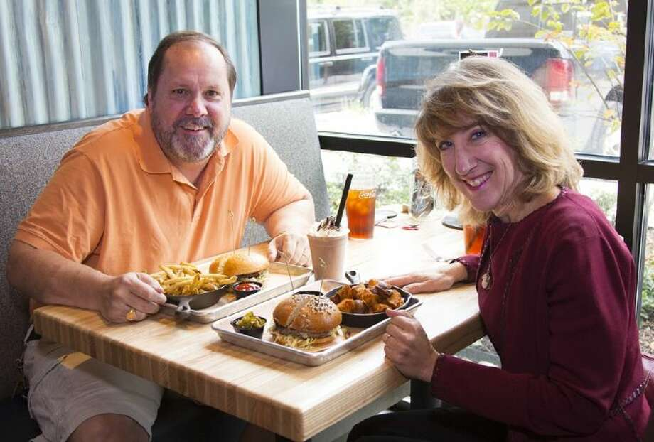 HCN restaurant critic Brad Meyer and food nutritionist Carolyn Wong sample some of the unique burgers at Fielding's Wood Grill in The Woodlands.