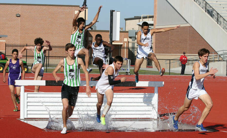 Glen Kelly, Sergio Rodriguez and Andrew Maritim lead the way for Kingwood in the 2000 meter steeplechase Saturday morning at Turner Stadium in Humble. Photo: Submitted Photo