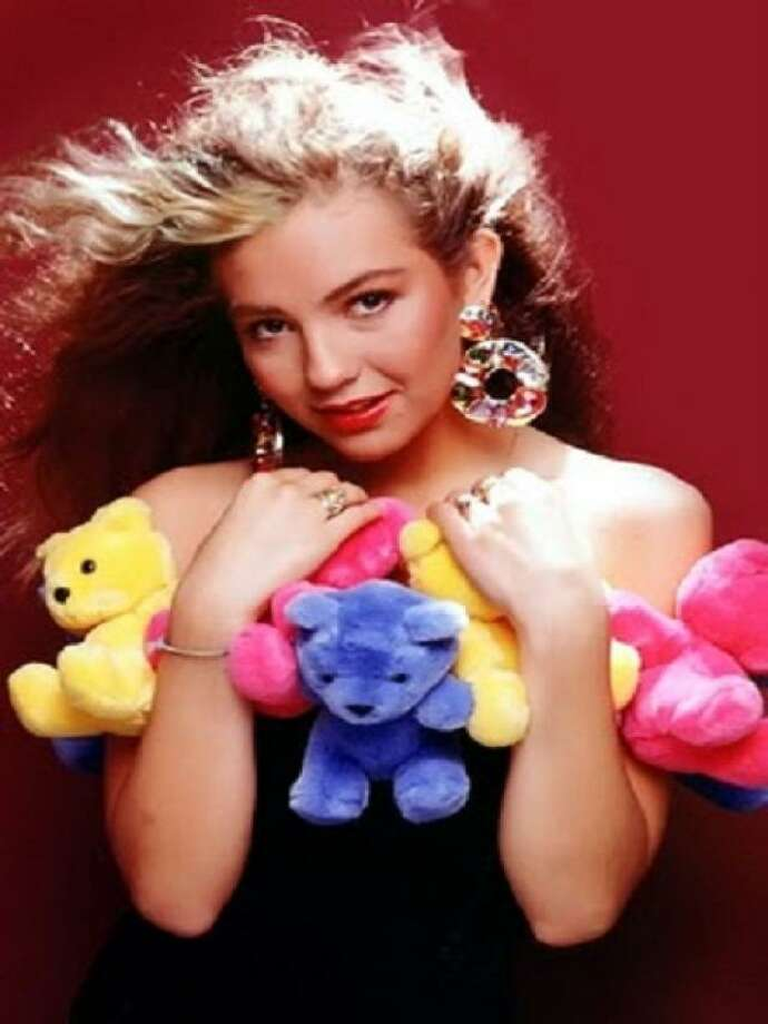 Thalia burst onto the scene as a solo act in 1990 with a quirky, colorful style that included stuffed animals tacked onto outfits.Click through for a look at Thalia's style evolution! Photo: Courtesy
