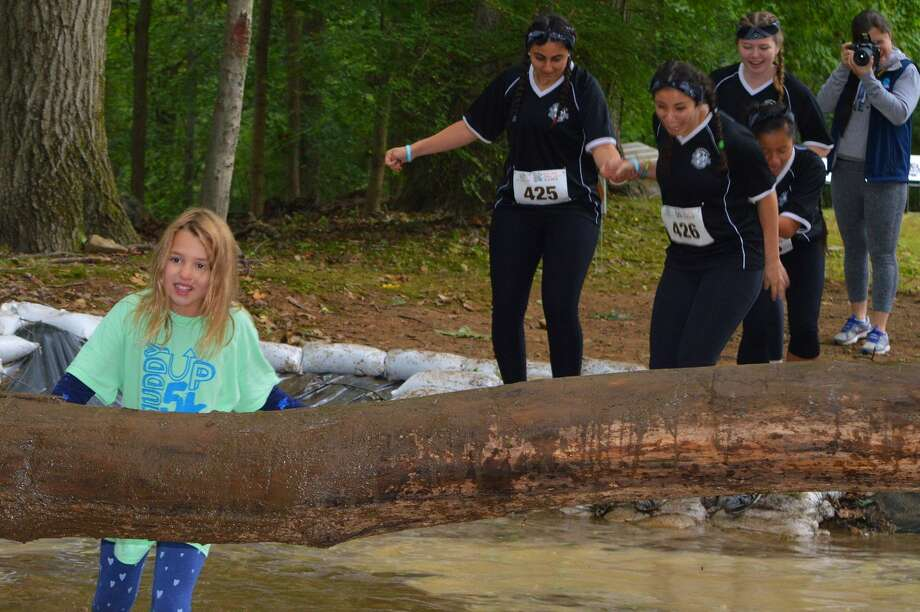 The Boys & Girls Club of Greenwich hosted its 5th Annual Muddy Up 5K Run and Walk on October 2, 2016 at Camp Simmons, the Club's 77-acre wilderness property. Runners and walkers of all ages enjoyed a competitive 3.1-mile adventure on wooded trails with natural and man-made obstacles and plenty of mud. Were you SEEN? Photo: Todd Tracy / Hearst CT Media Group