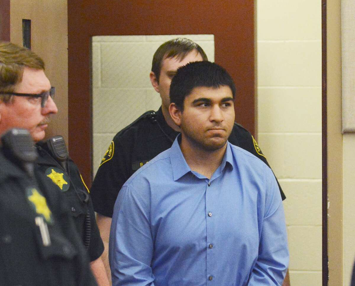 FILE - In this Monday, Sept. 26, 2016 file photo, Arcan Cetin is escorted into Skagit County District Court by Skagit County's Sheriff's Deputies. Cetin reportedly hung himself in Snohomish County Jail, Skagit County Prosecutor Rich Weyrich announced Monday.