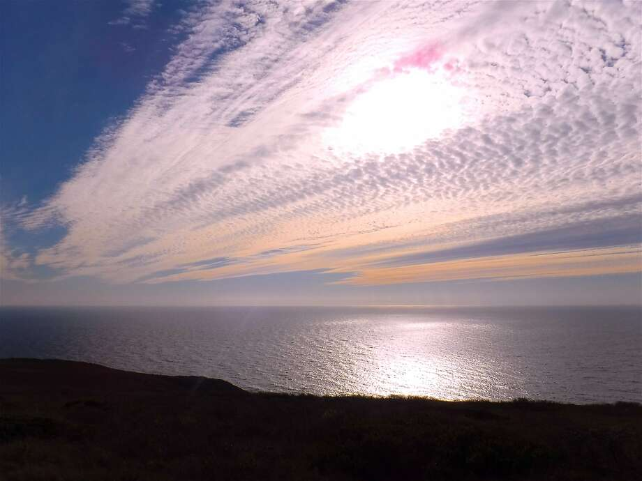 In the fall, the sun's lower angle in the sky and alto cirrus clouds often results in the spectrum of reds, oranges and yellows off the Marin Coast Photo: Tom Stienstra, Tom Stienstra / The Chronicle