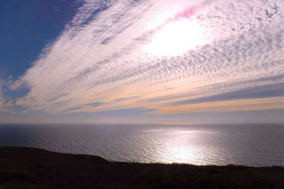In the fall, the sun's lower angle in the sky and alto cirrus clouds often results in the spectrum of reds, oranges and yellows off the Marin Coast