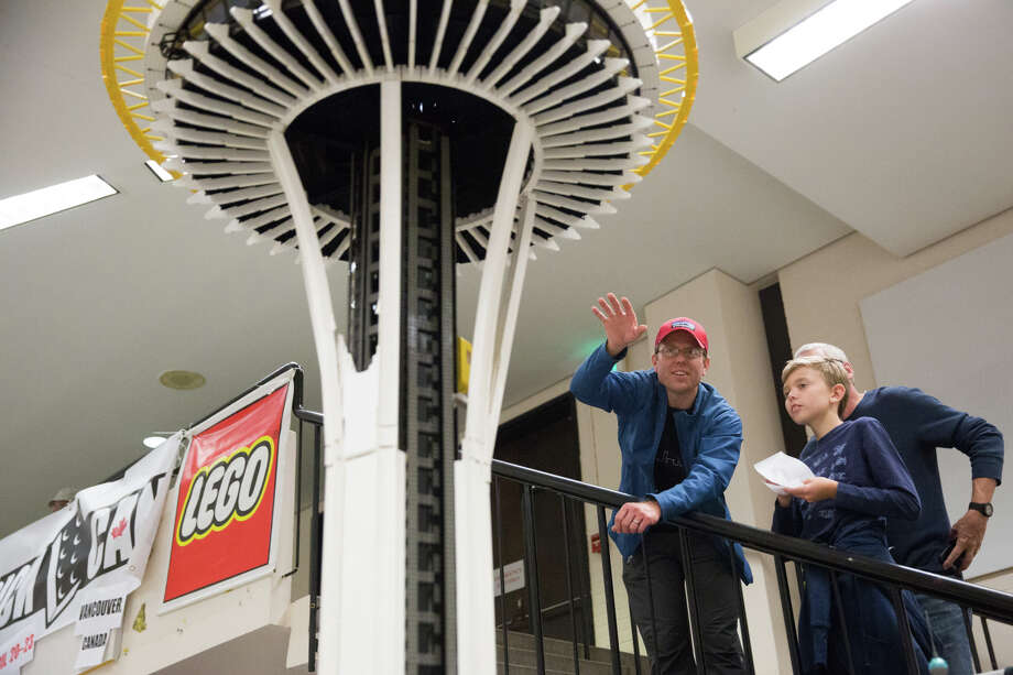 Fans check out a Lego recreation of the Space Needle by Wayne Hussey at BrickCon at the Seattle Center Exhibition Hall on Saturday, Oct. 1, 2016. Photo: GRANT HINDSLEY, SEATTLEPI.COM / SEATTLEPI.COM
