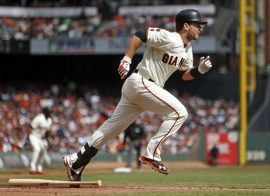 San Francisco Giants' Buster Posey hits a 2-run single in 1st inning against Los Angeles Dodgers during MLB game at AT&T Park in San Francisco, Calif., on Sunday, October 2, 2016. Photo: Scott Strazzante, The Chronicle