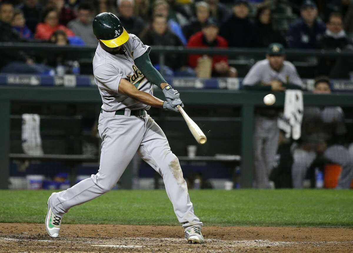 Oakland Athletics' Marcus Semien hits a ground-rule double to score Joey Wendle during the eighth inning of a baseball game against the Seattle Mariners, Saturday, Oct. 1, 2016, in Seattle. (AP Photo/Ted S. Warren)