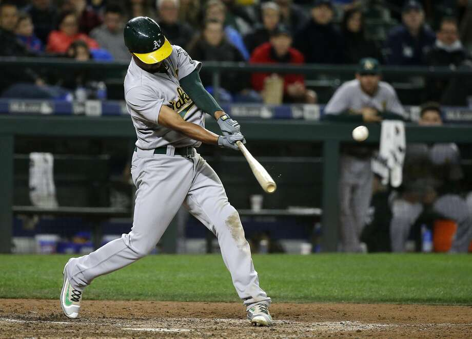 A's shortstop Marcus Semien, seen hitting a ground-rule double to score Joey Wendle during the eighth inning Saturday, raised his home-run total from 15 to 27 this past season. Photo: Ted S. Warren, Associated Press