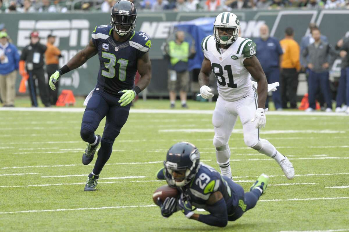 New York Jets wide receiver Quincy Enunwa (81) and Seattle Seahawks' Kam Chancellor (31) watch as Earl Thomas (29) intercepts a pass during the second half of an NFL football game Sunday, Oct. 2, 2016, in East Rutherford, N.J. (AP Photo/Bill Kostroun)