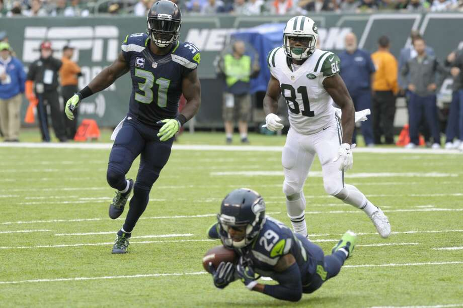 New York Jets wide receiver Quincy Enunwa (81) and Seattle Seahawks' Kam Chancellor (31) watch as Earl Thomas (29) intercepts a pass during the second half of an NFL football game Sunday, Oct. 2, 2016, in East Rutherford, N.J.  (AP Photo/Bill Kostroun) Photo: Bill Kostroun/AP