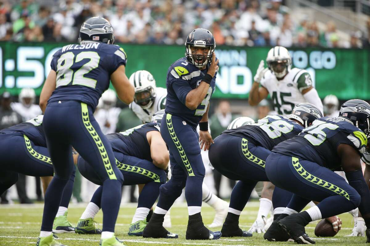 Seattle Seahawks quarterback Russell Wilson (3) gestures to Luke Willson (82) during the second half of an NFL football game against the New York Jets Sunday, Oct. 2, 2016, in East Rutherford, N.J. (AP Photo/Kathy Willens)