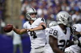Oakland Raiders quarterback Derek Carr throws to a receiver in the second half of an NFL football game against the Baltimore Ravens, Sunday, Oct. 2, 2016, in Baltimore. (AP Photo/Nick Wass)