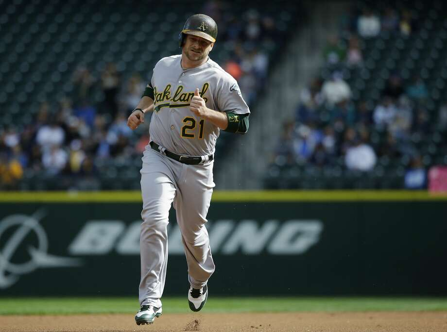 Oakland Athletics' Stephen Vogt rounds the bases after hitting a solo home run in the first inning of a baseball game against the Seattle Mariners, Sunday, Oct. 2, 2016, in Seattle. (AP Photo/Ted S. Warren) Photo: Ted S. Warren, Associated Press