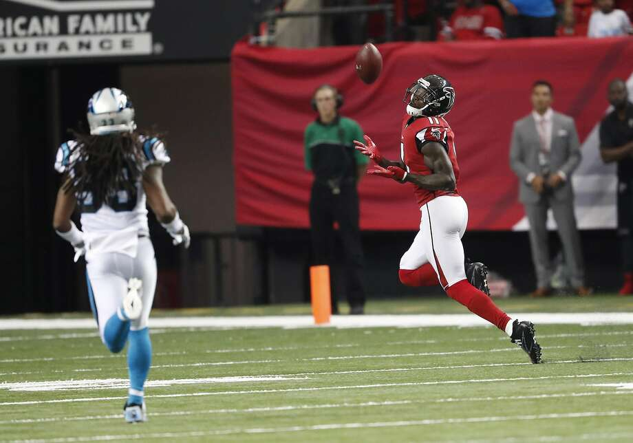 Falcons wide receiver Julio Jones makes one of his 12 receptins against the Panthers. Photo: John Bazemore, Associated Press