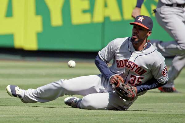 Houston Astros right fielder George Springer cannot get to a hit by Los Angeles Angels' Cliff Pennington in the second inning of a baseball game in Anaheim, Calif., Sunday, Oct. 2, 2016. (AP Photo/Reed Saxon)