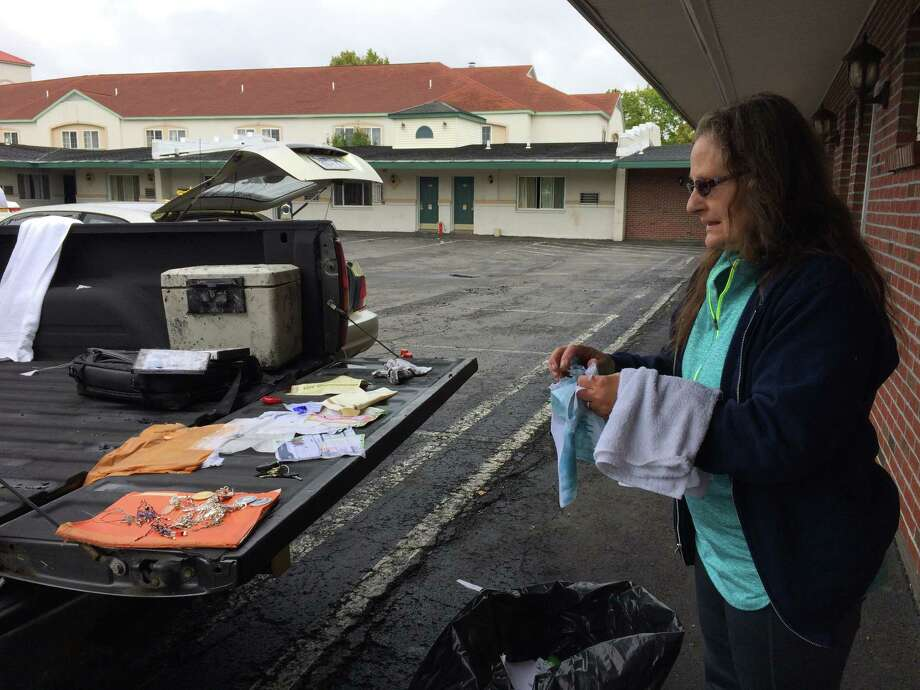 Rose O'Dell, 61, sets out the few things she and her husband, Timothy, were able to find after a fire destroyed the Travelodge efficiency they lived in for 22 years on Saturday, Oct. 1, 2016. The O'Dells narrowly escaped the blaze, which started in the room below their apartment. (Lauren Stanforth)