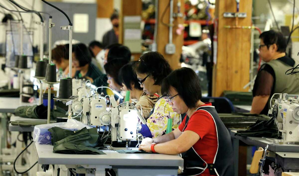 A group of workers at the C.C. Filson Co. manufacturing facility work at their sewing machines in Seattle. The United States isn't exactly the economic doormat that Republican presidential candidate Donald Trump decries in his campaign rhetoric.