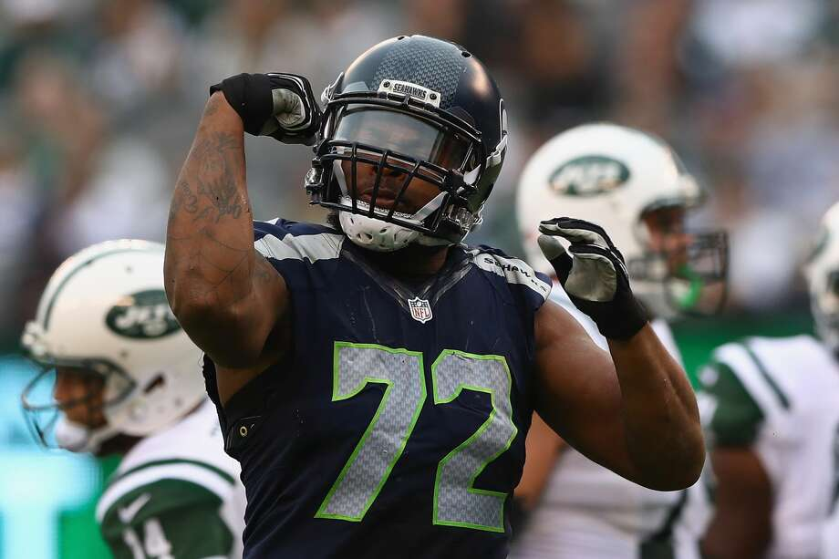 Seahawks head coach is counting on defensive end Michael Bennett returning versus the Carolina Panthers next Sunday. Photo: Elsa/Getty Images