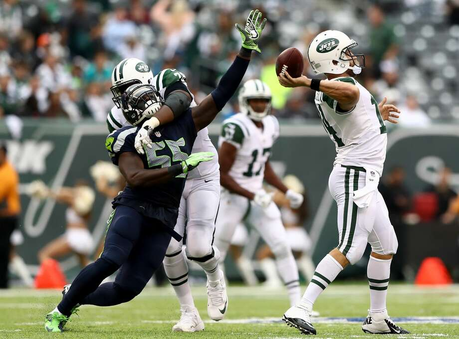 Ryan Clady of the New York Jets stops  Frank Clark of the Seattle Seahawks as he tries to get his hand on the ball as Ryan Fitzpatrick #14 of the Jets passes in the fourth quarter at MetLife Stadium on October 2, 2016 in East Rutherford, New Jersey. Photo: Elsa/Getty Images