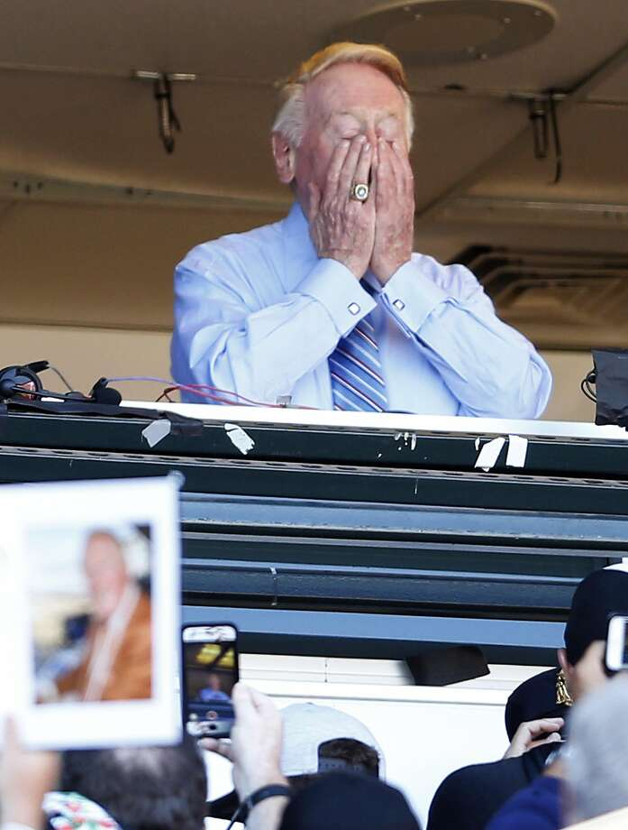 Los Angeles Dodgers' legendary announcer Vin Scully gets emotional during the 7th inning stretch of Scully's final regular season broadcast during Dodgers' game against San Francisco Giants at AT&T Park in San Francisco, Calif., on Sunday, October 2, 2016. Photo: Scott Strazzante, The Chronicle