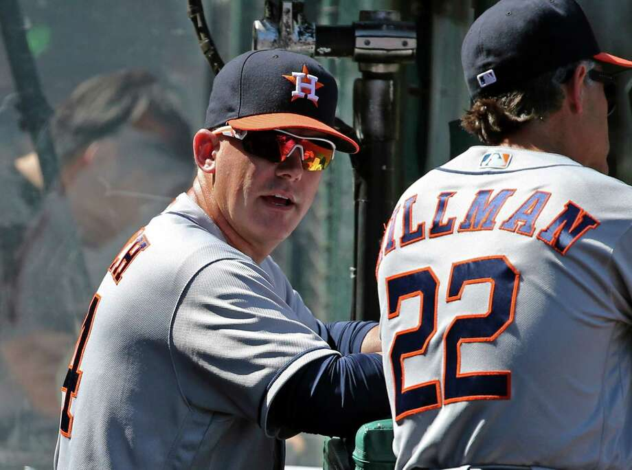 Houston Astros manager A.J. Hinch, left, talks with bench coach Trey Hillman during a baseball game against the Los Angeles Angels in Anaheim, Calif., Sunday, Oct. 2, 2016. (AP Photo/Reed Saxon) Photo: Reed Saxon, Associated Press / Copyright 2016 The Associated Press. All rights reserved. This material may not be published, broadcast, rewritten or redistribu