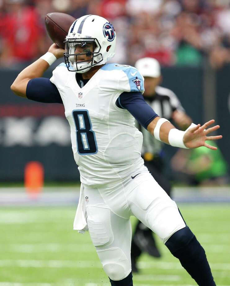 Tennessee Titans quarterback Marcus Mariota (8) throws a pass against the Houston Texans during the second quarter of an NFL football game at NRG Stadium on Sunday, Oct. 2, 2016, in Houston. Photo: Brett Coomer, Houston Chronicle / © 2016 Houston Chronicle