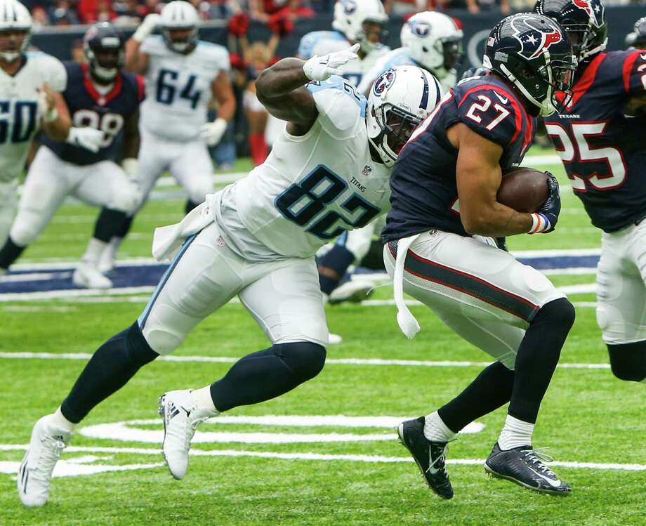 Houston Texans strong safety Quintin Demps (27) intercepts a pass intended for Tennessee Titans tight end Delanie Walker (82) during the second quarter of an NFL football game at NRG Stadium on Sunday, Oct. 2, 2016, in Houston. Photo: Brett Coomer, Houston Chronicle / © 2016 Houston Chronicle