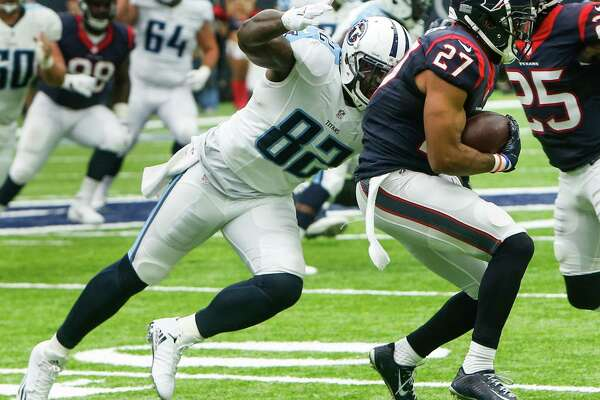Houston Texans strong safety Quintin Demps (27) intercepts a pass intended for Tennessee Titans tight end Delanie Walker (82) during the second quarter of an NFL football game at NRG Stadium on Sunday, Oct. 2, 2016, in Houston.
