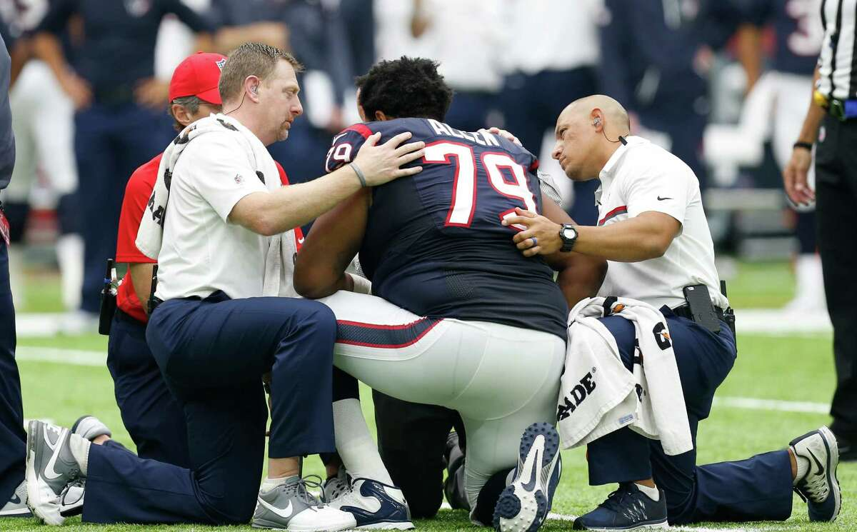 Houston Texans offensive guard Jeff Allen (79) is checked out by the Texans medial staff after he was injured during the third quarter of an NFL football game against the Tennessee Titans at NRG Stadium on Sunday, Oct. 2, 2016, in Houston.