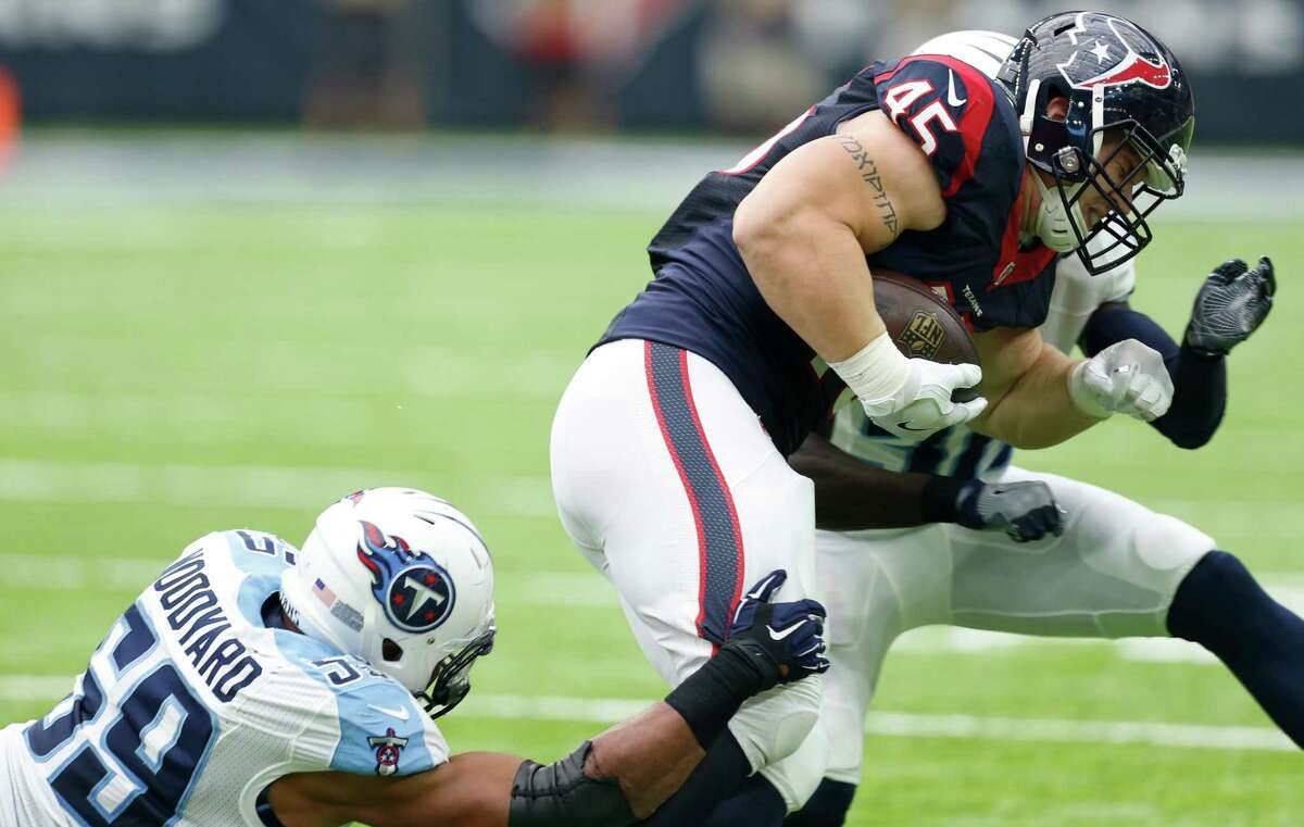 Houston Texans fullback Jay Prosch (45) is tackled by Tennessee Titans inside linebacker Wesley Woodyard (59) on a first down reception during the third quarter of an NFL football game at NRG Stadium on Sunday, Oct. 2, 2016, in Houston.