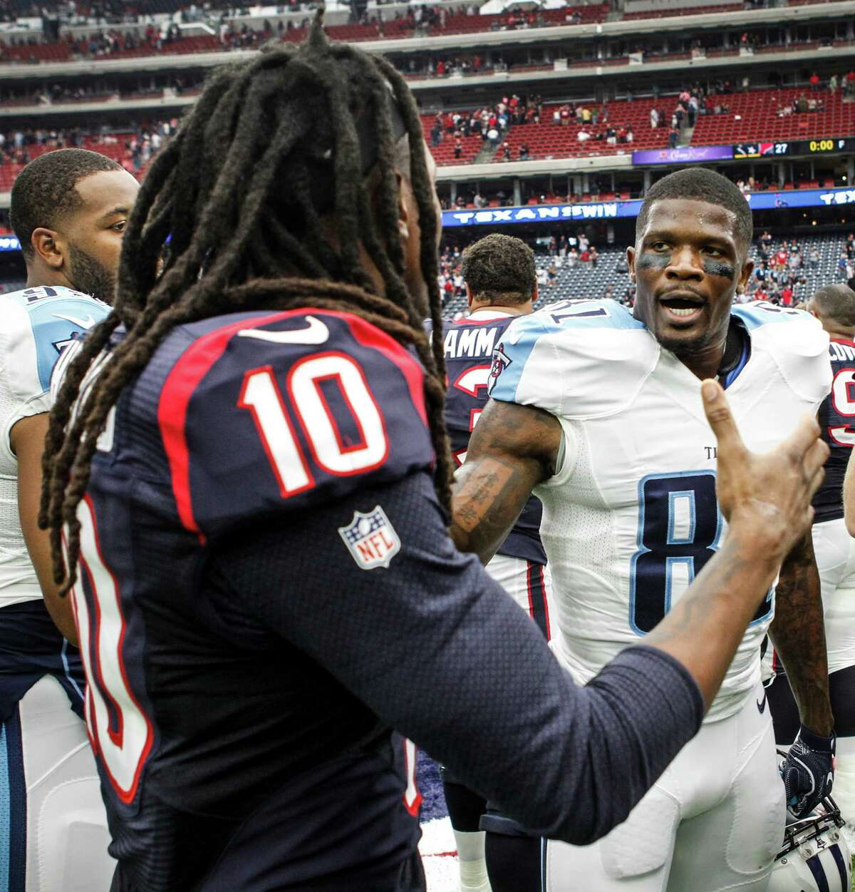 Houston Texans wide receiver DeAndre Hopkins (10) and former Texans and current Tennessee Titans wide receiver Andre Johnson (81) shake hands after the Texans 27-20 win over the Titans at NRG Stadium on Sunday, Oct. 2, 2016, in Houston.