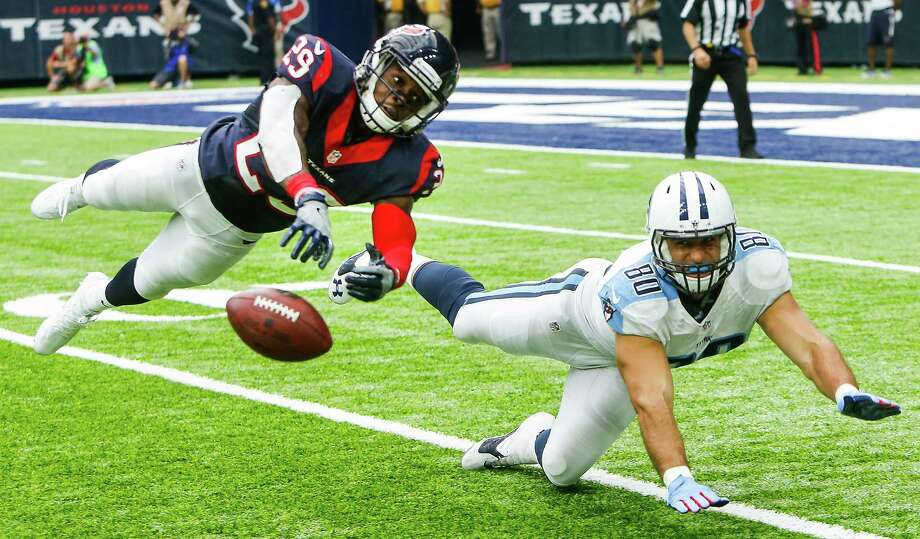 Houston Texans free safety Andre Hal (29) breaks up a pass intended for Tennessee Titans tight end Anthony Fasano (80) during the fourth quarter of an NFL football game at NRG Stadium on Sunday, Oct. 2, 2016, in Houston. Photo: Brett Coomer, Houston Chronicle / © 2016 Houston Chronicle