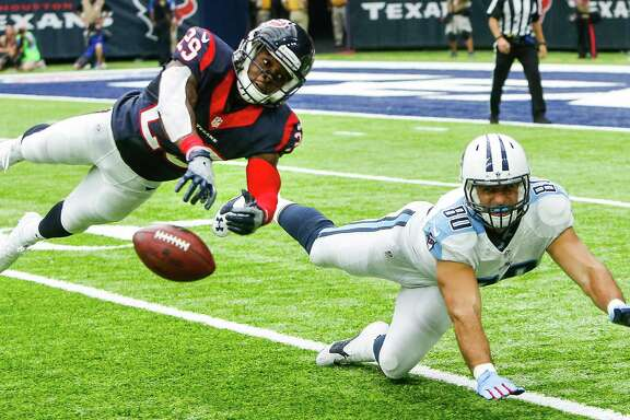 Houston Texans free safety Andre Hal (29) breaks up a pass intended for Tennessee Titans tight end Anthony Fasano (80) during the fourth quarter of an NFL football game at NRG Stadium on Sunday, Oct. 2, 2016, in Houston.