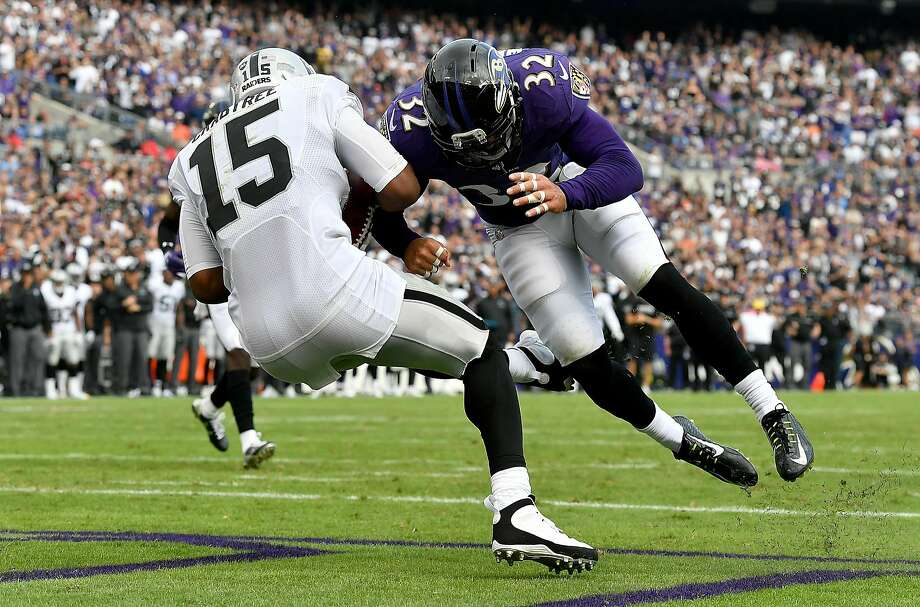 Baltimore's Eric Weddle (32) hits Michael Crabtree in the fourth quarter on Crabtree's second touchdown. After the play, Weddle went to the locker room to be checked for a concussion. Photo: Larry French, Getty Images