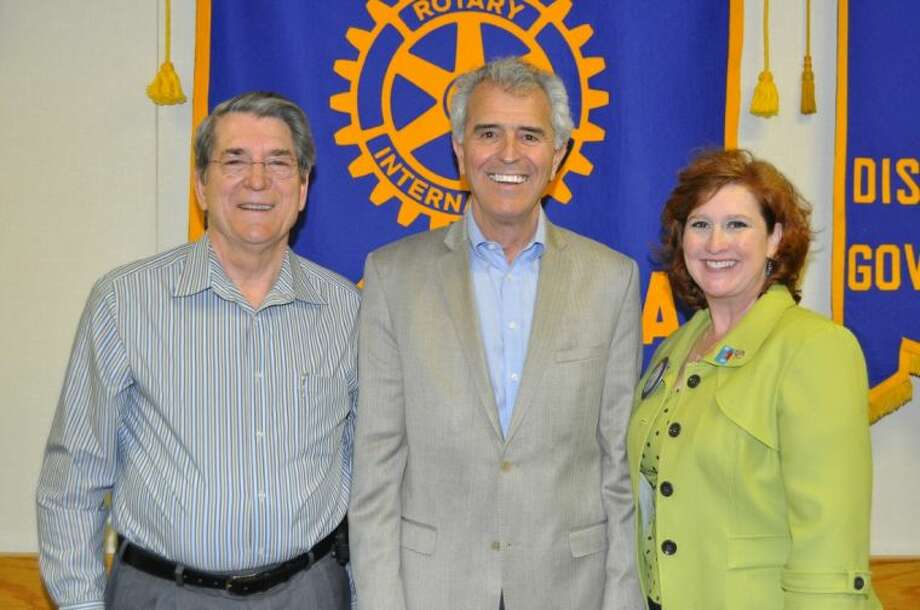 """Pasadena Rotary member John Moon (L), accompanied by President-elect Dana Philibert (R) introduced guest speaker Grove Norwood, the founder and Chairman of the """"The Heart of Texas Foundation, Inc."""" Photo: BILL WELCH"""