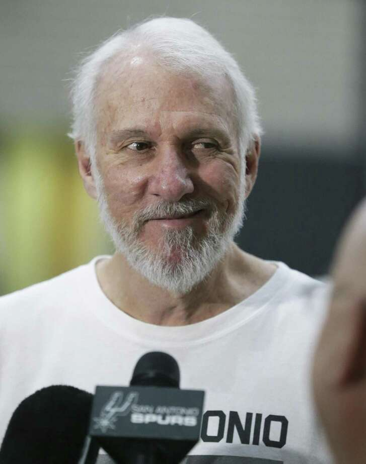 Coach Popovich smiles after a joke about players as the Spurs practice on September 28, 2016.