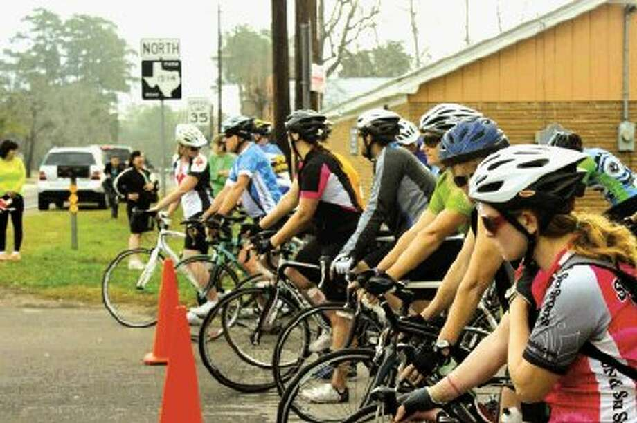 Riders wait outside the San Jacinto County Courthouse for the start of the Bike Through the Forest and the Hills, an annual fundraiser for the Kingwood Fillies. The 2014 Bike Ride will be held on Jan. 25 in Coldspring.