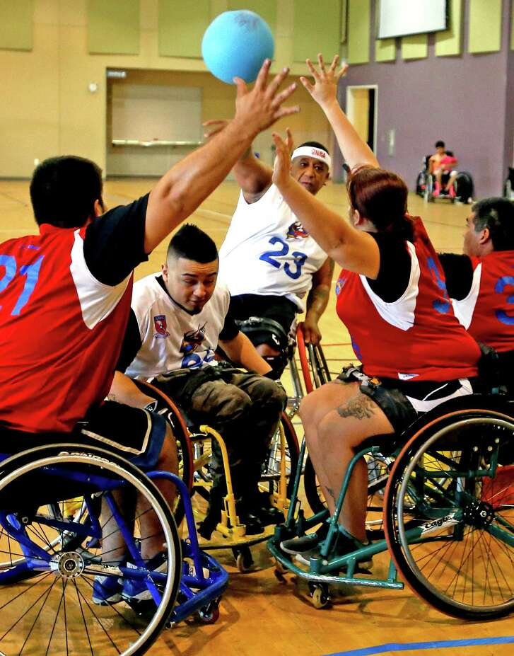 Nakia Merritte,23, playing for STRAPS-Hawks tries to score on STRAPS-Stars during an intramural game for South Texas Regional Adaptive & Paraylympis Sports (STRAPS)  at Morgan Wonderland Events Center on Sunday, October 2, 2016.